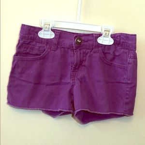 Girls' Purple cutoff shorts with Iight sparkles.